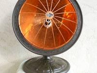 This polished copper dish heater Model #98 with a