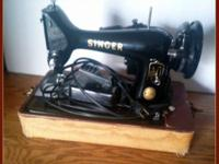 This is a very nice Singer Portable Sewing Machine