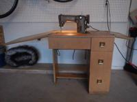Classic 1954 Singer sewing machine and cabinet. This