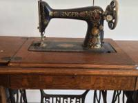 This is a vintage sewing machine made by Singer for