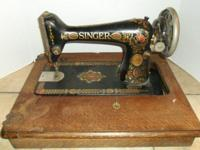 Vintage Red Eye Singer Sewing Machine. Circa 1910.