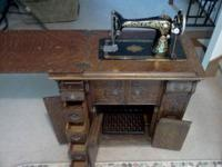 WE ARE SELLING AN ANTIQUE SINGER TREADLE SEWING