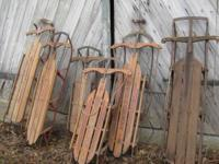 Six vintage sleds:  2 Speed a Way (each 55 inches); 1