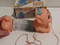 Adorable pink Slinky Kitten with original box. Great