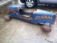 I am offering this antique soap box derby vehicle from