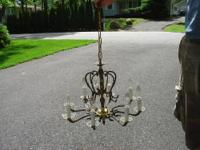 This is a lovely ornamental brass and Crystal