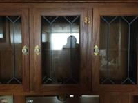 Vintage golden oak hutch features porcelin knobs, glass