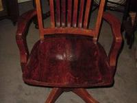 THIS IS A SOLID ANTIQUE OAK OFFICE ARM CHAIR ON COASTER