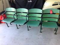 Area of four vintage stadium seats. Cast iron frame and