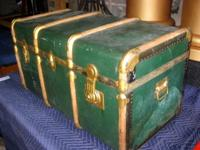 Vintage, metal skinned steamer trunk with exterior wood