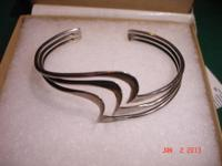 For sale one vintage sterling silver modernist triple