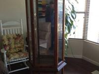 This is a full curved picture-frame front glass curio