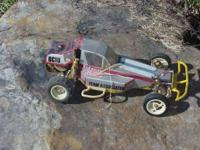 This is an aluminum frame vintage RC-10 buggy by team