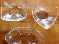 Vintage clear glass candy dishes with teardrop feet.