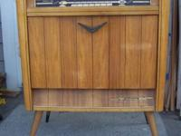 This vintage tube radio and cabinet has possibilities