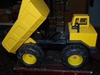 This is a vintage all steel Tonka Dump Truck in