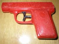 This little red water gun is made of plastic. It is