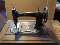 Vintage sewing machine in cabinet; I inherited it and