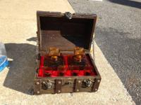 A vintage 1960's treasure chest decanter set. Comes