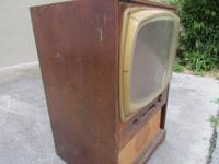 PRICE LOWERED!!  This is a vintage tv cabinet that has