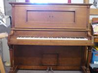 Tiger oak antique upright piano and beautiful Builder