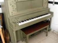 Vintage upright piano from the 1920's. Great