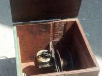 Offering a Vintage Victrola Motor Fishing Reel Box Hand