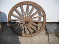 Here are 2 antique wooden wagon wheels in good shape.