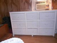 This is a vintage wicker nine drawer chest/buffet.