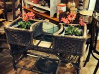 We just brought in an amazing wicker planter with the