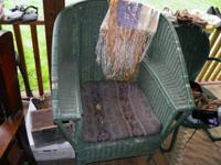 Vintage wicker chair, a few spots are missing wicker,