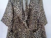 Vintage faux fur leopard coat from 1950s. Coat is