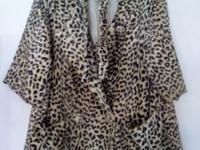 Vintage faux fur leopard coat from 1950s. Coat is