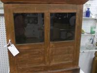 Classic folk wood cabinet w/glass in door. Perfect for