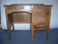 Vintage Used Wood Writing Desk. It has a Pull out