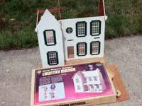 This listing is for a great vintage wooden dollhouse