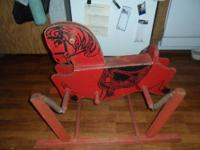 Up for sale, a vintage wooden hobby horse. It's red in
