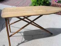 Old wooden folding ironing board in excellent