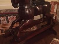 This Vintage, wooden rocking horse, located as a