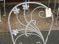 Set of 5 wrought iron chairs with floral design back.