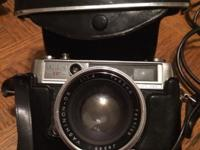 In almost perfect condition Leather attached case has a