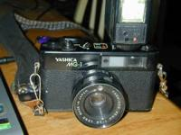 Vintage Yashica MG-1 35MM camera with strap and Vivatar