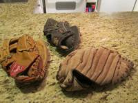 Vintage leather baseball gloves, $30 for all three..