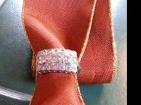 Size 7. Lovely diamond ring. 3 large stones surrounded