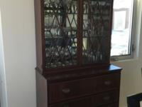 This beautiful secretary desk has a mirrored hutch with