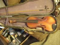 This Violin is very old, comes with case and bow..