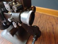 Bell and Howell 16MM Filmo Diplomat projector with