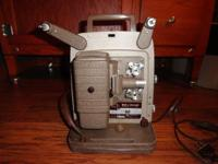 Vintage Bell and Howell 8MM projector, has been plugged