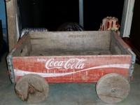 I have a vintage Coca Cola wooden crate wagon. About