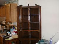 "Description 72"" high 2 glass doors and two wooden"